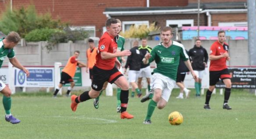 Alex Jones went close for Prestatyn Town early on against Caernarfon Town