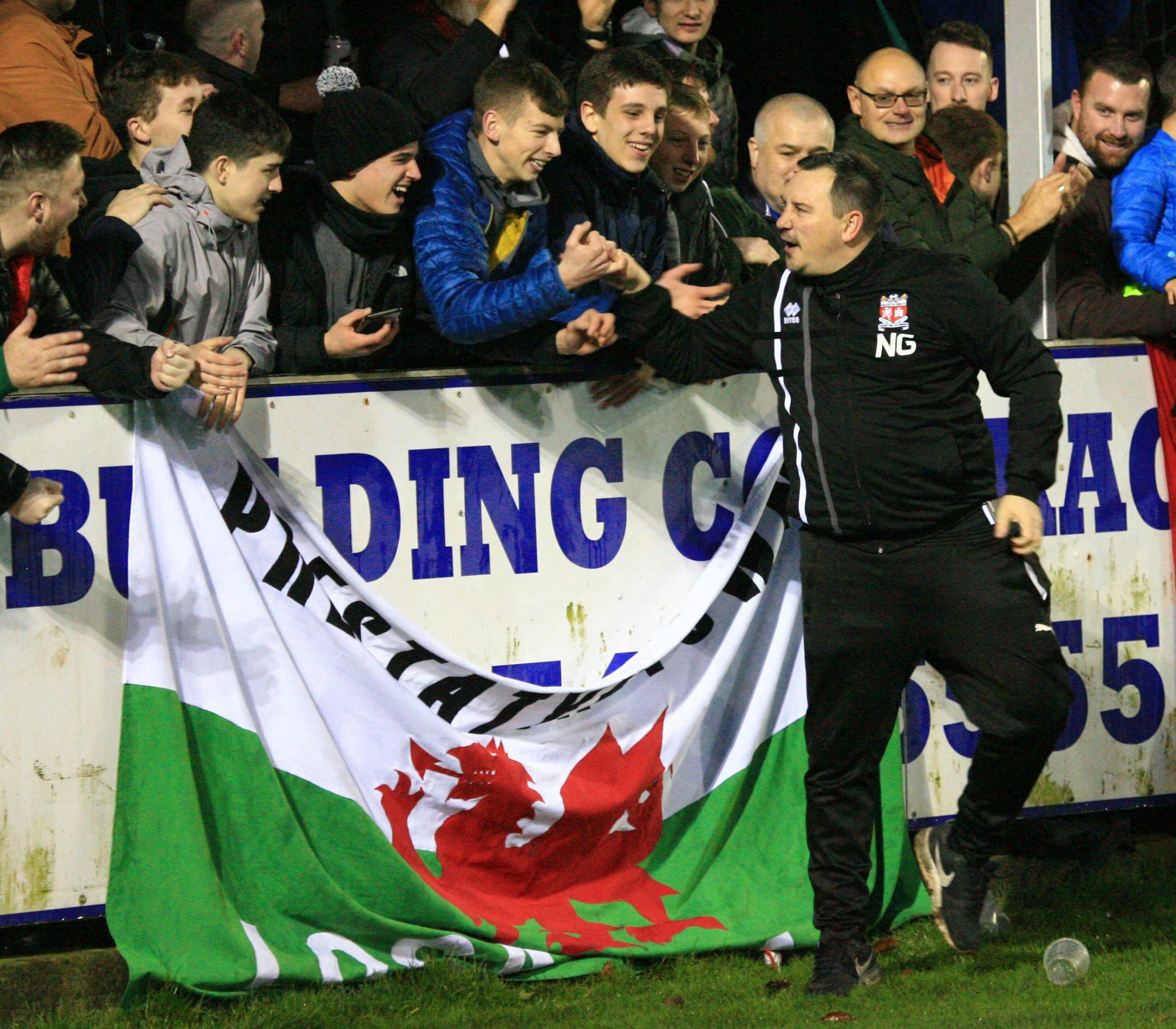 Prestatyn Town manager Neil Gibson celebrates with supporters after their win over Rhyl (Photo by Gareth Hughes)