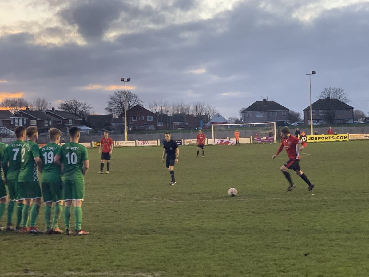 Dave Hayes runs up to his stunning free-kick equaliser for Prestatyn Town (Photo by Tony O'Reilly)