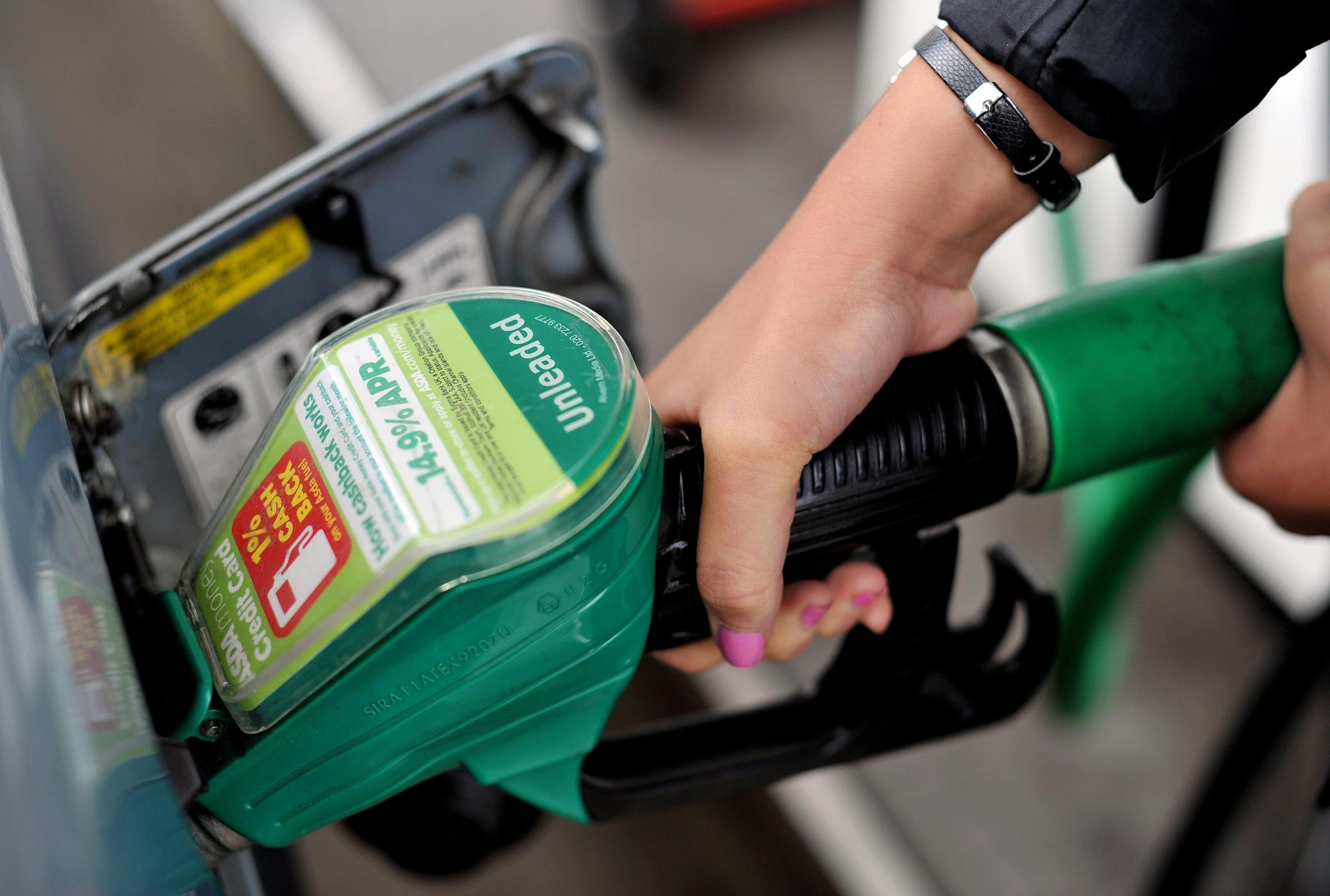 File photo dated 15/8/13 of a person using an Asda petrol pump. The supermarket is to cut its petrol and diesel prices amid claims that fuel retailers are overcharging motorists. PRESS ASSOCIATION Photo. Issue date: Monday January 7, 2019. See PA story T