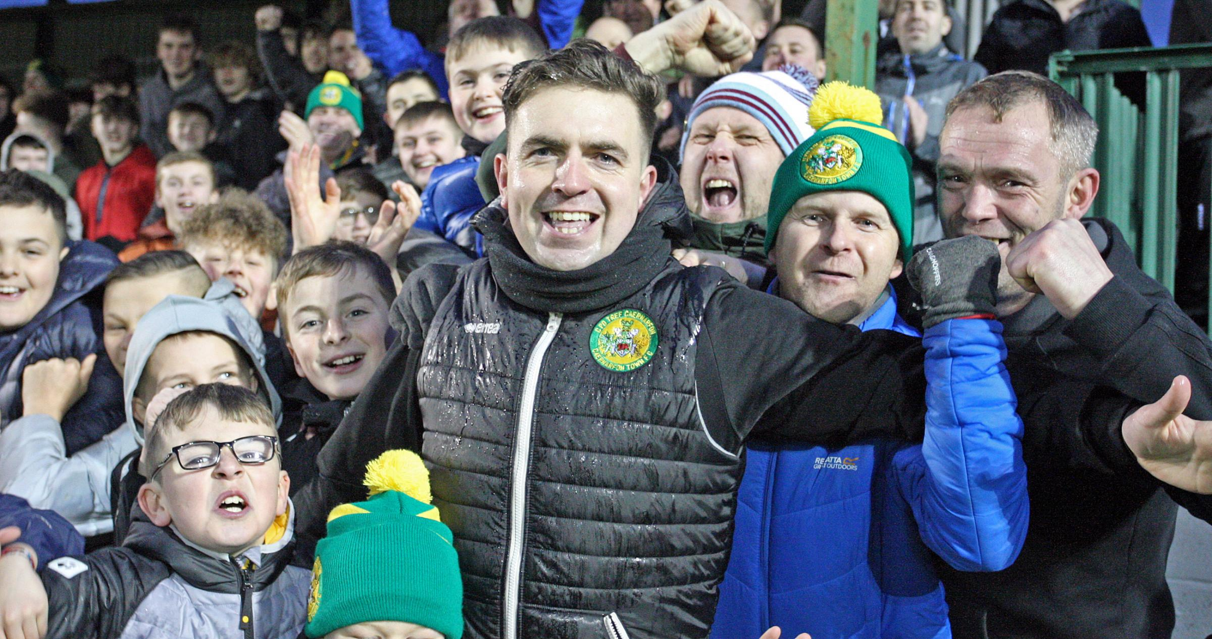 Caernarfon Town manager Sean Eardley celebrates their top six berth with supporters (Photo by Richard Birch)