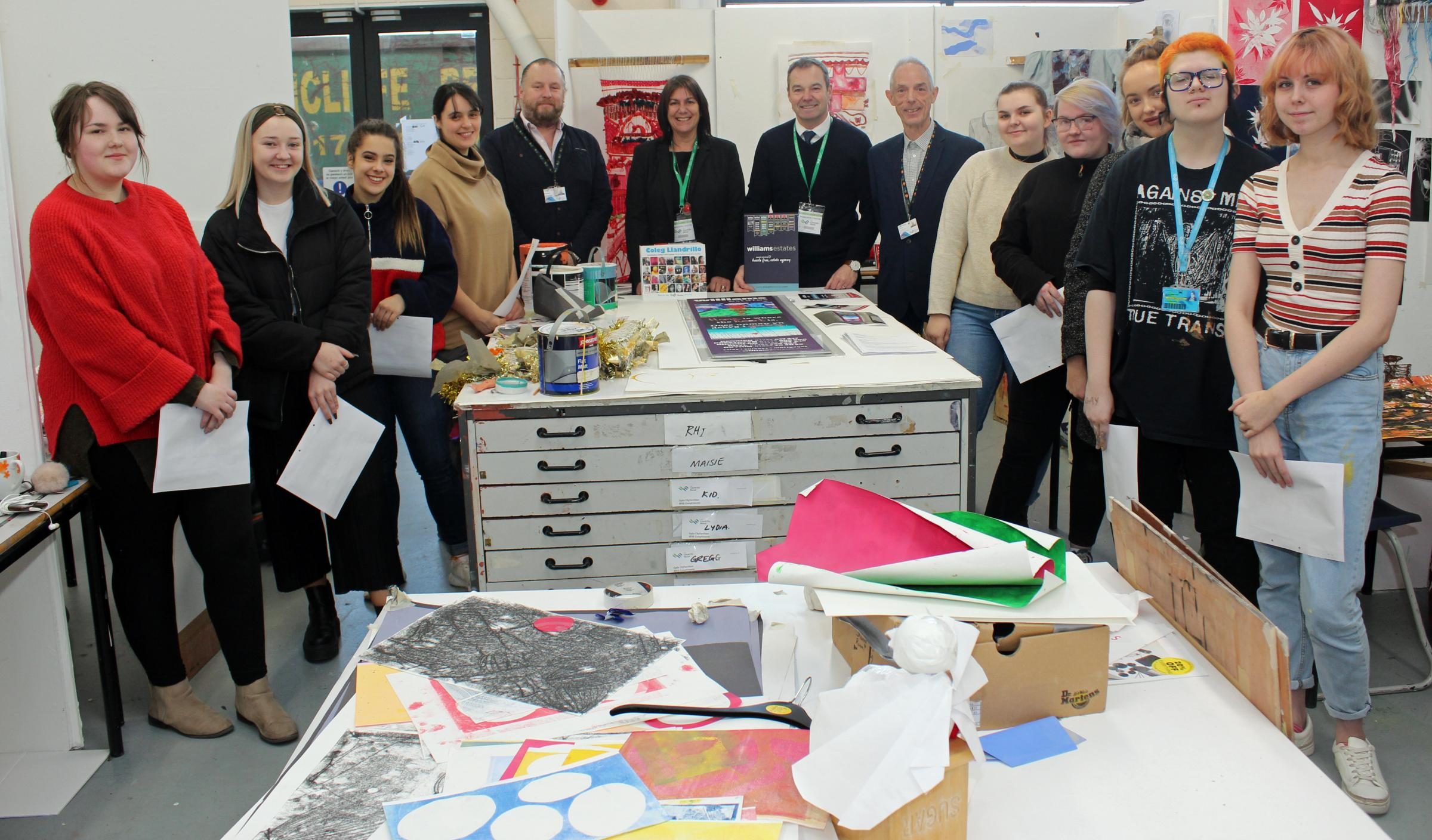 Jason Williams (centre right) with staff and students from Coleg Llandrillo's Arts' department