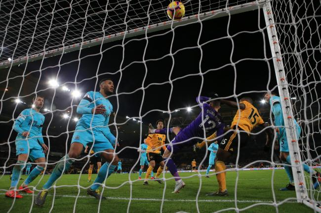 Wolves' Willy Boly heads in the late equaliser against Newcastle.