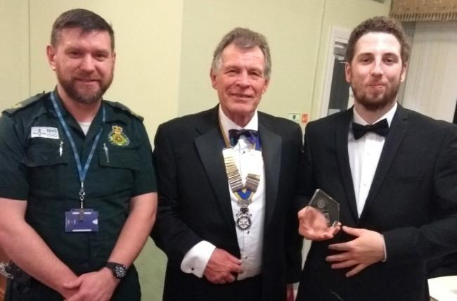 Gareth Williams, First Responder Trainer for Wales Ambulance Service; John Dicks, president of St Asaph Rotary Club and Andrew Underwood (holding the trophy), First Responder Volunteer