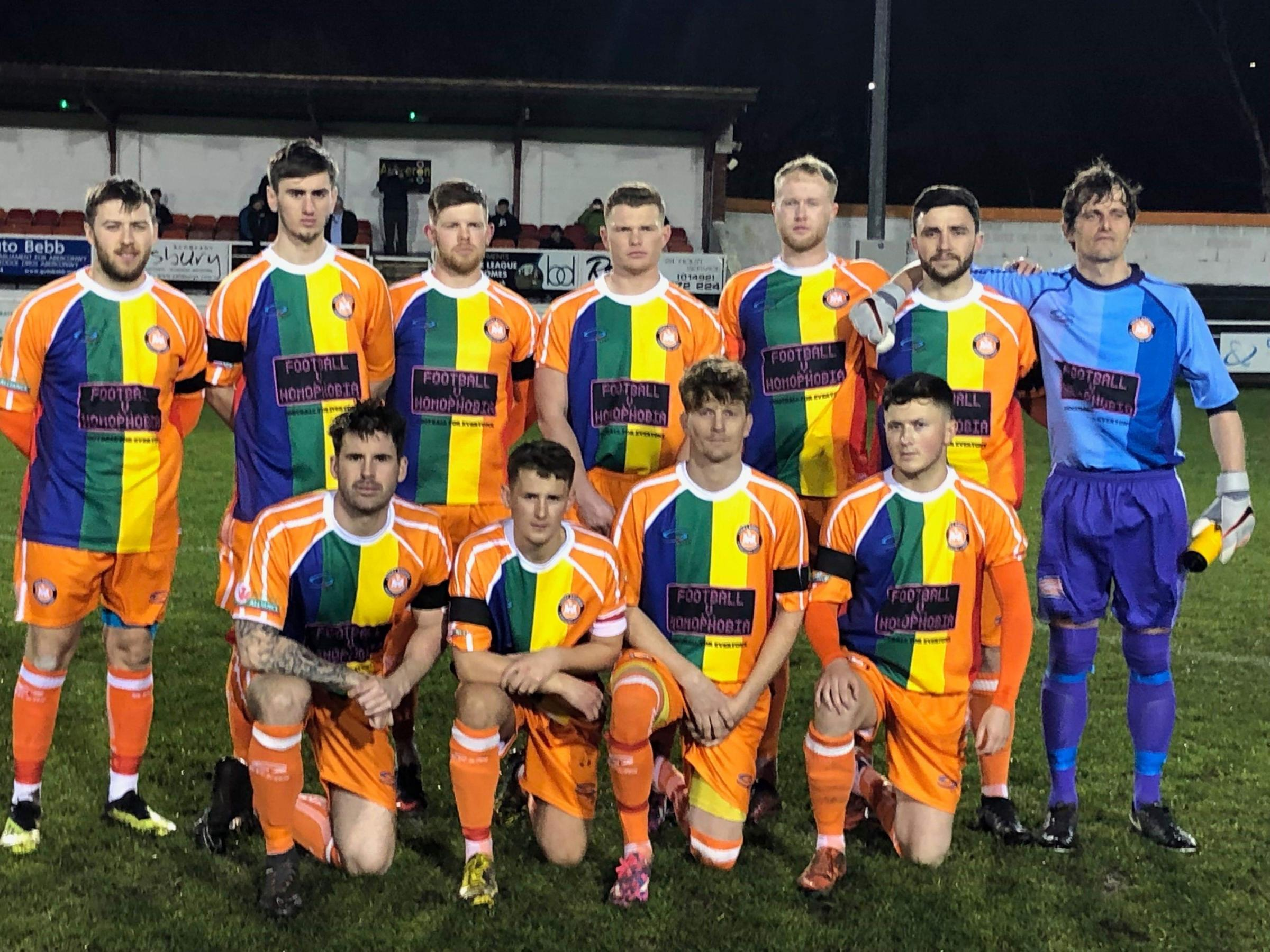 Conwy Borough line up in their Football vs Homophobia shirts before their game with Prestatyn Town