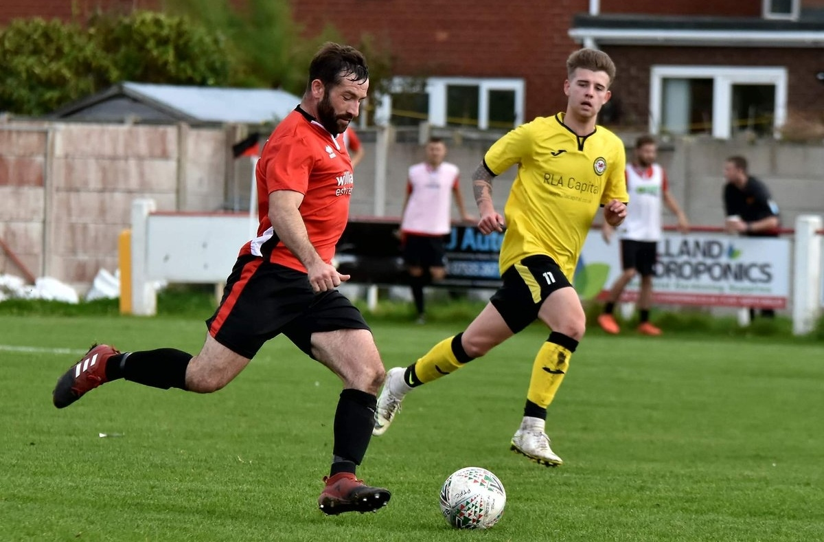 Prestatyn Town were beaten in a physical game at Guilsfield