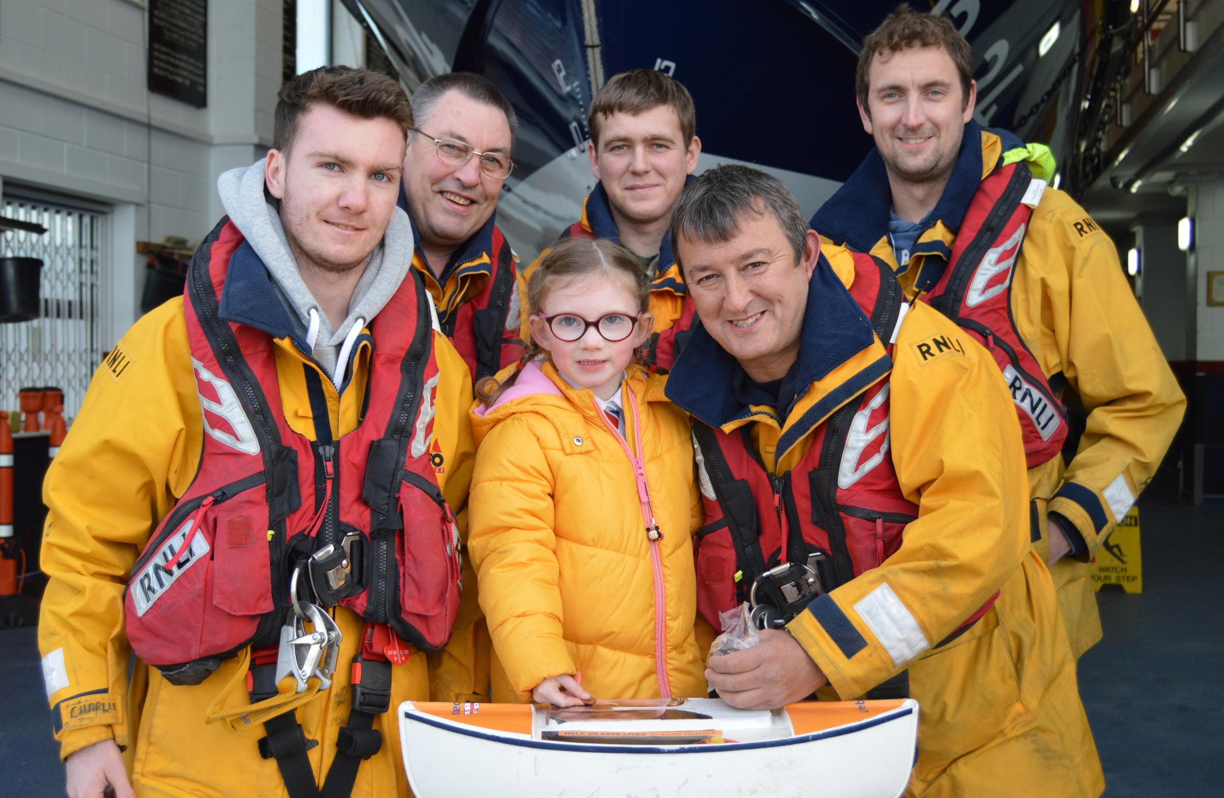 Darcey is pictured with Rhyl RNLI crew members Charlie Williams, Paul Frost, Dougie Lonsdale, Martin Jones and Andy Wilde