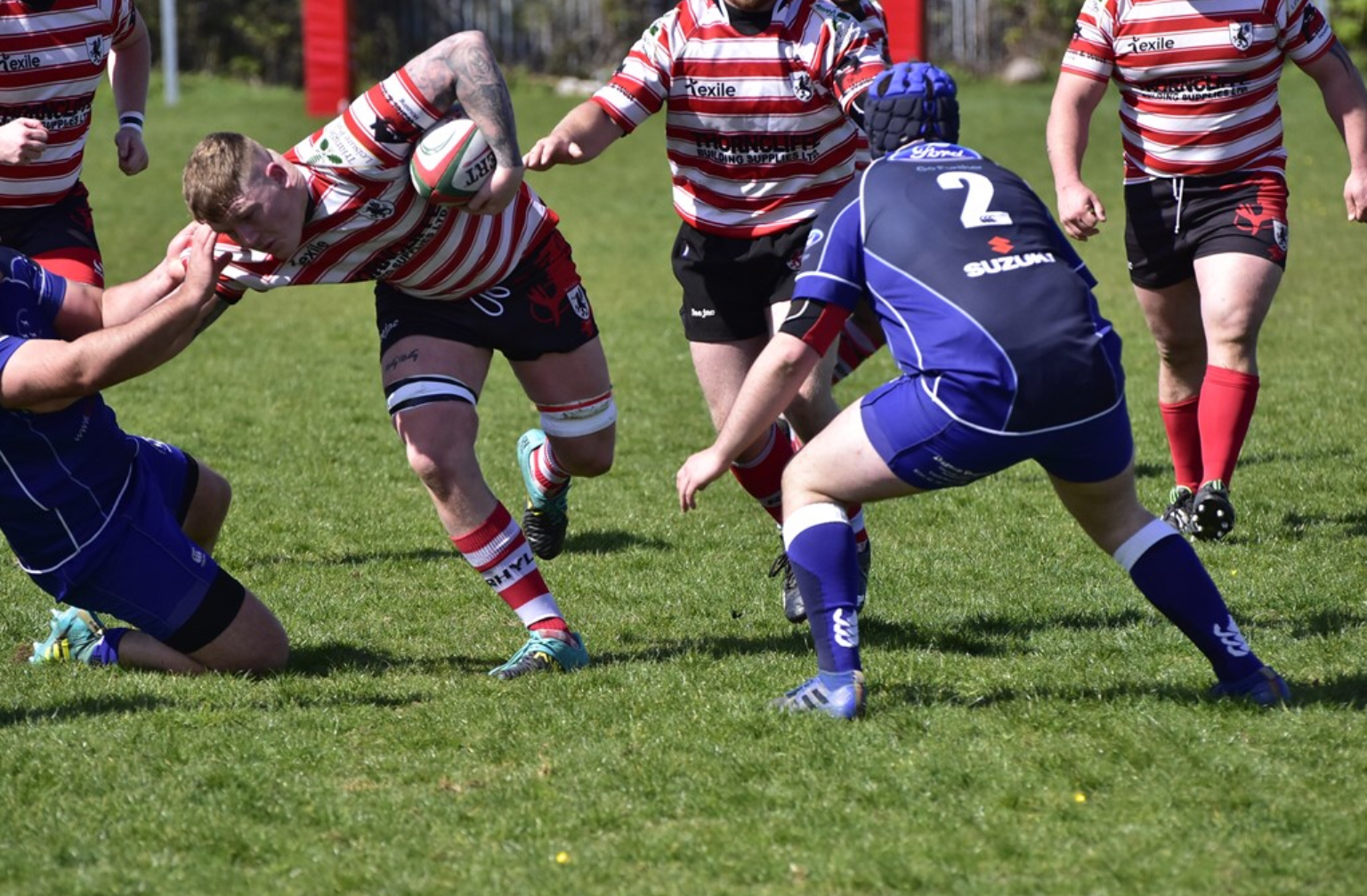 James Fisher-Jones tries to get through the strong Dolgellau defence. Photo by Paul Brookes