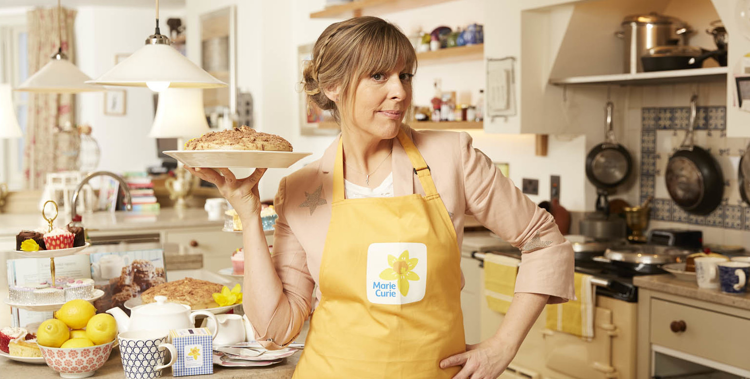 Marie Curie and Mel Giedroyc are calling on the people of Rhyl to throw a Blooming Great Tea Party this June