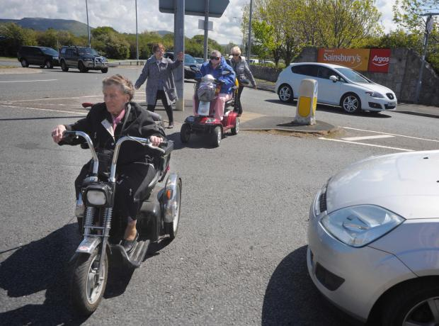 Protestors On Mobility Scooters Rally Together In Hope Of