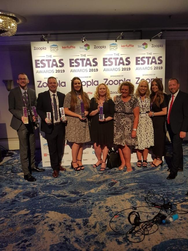 The William Estates' team celebrating their success at the awards evening