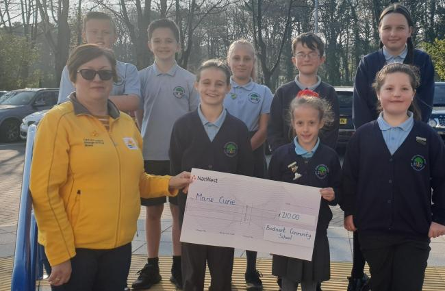 Pupils at Bodnant Community School presented a cheque
