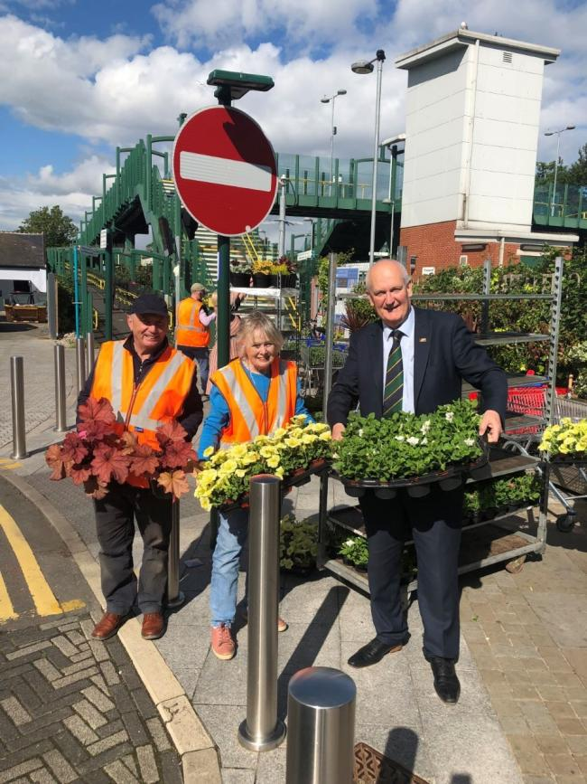 Vale of Clwyd MP Chris Ruane lends a hand to the Friends of Prestatyn Railway Station